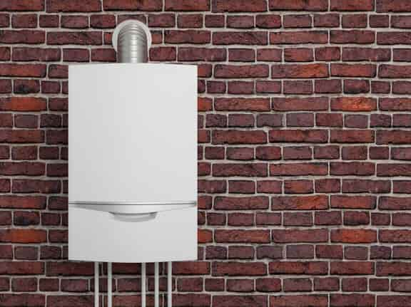 this is a photo of a combi boiler fitted to a brick wall
