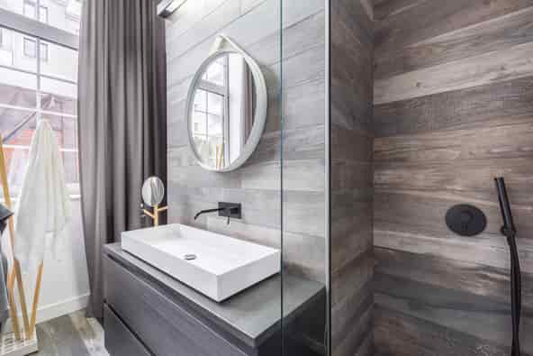 This is a photo of a bathroom with a shower and basin